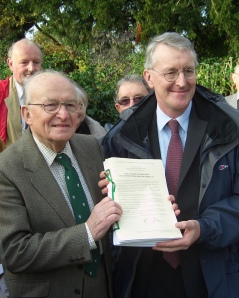Hilary Benn MP with Robin Crane, chairman of the South Downs Campaign holding a signed copy of the Confirmation Order, 12 November, 2009