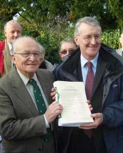Hilary Benn MP with Robin Crane, chairman of the South Downs Campaign holding a signed copy of the Confirmation Order